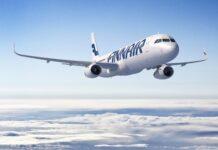 samolot finnaor nad chmurami