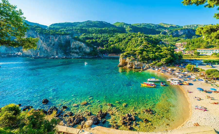 Beautiful-beach-and-boat-in-Paleokastritsa-Corfu-island-Greece-shutterstock_517476949