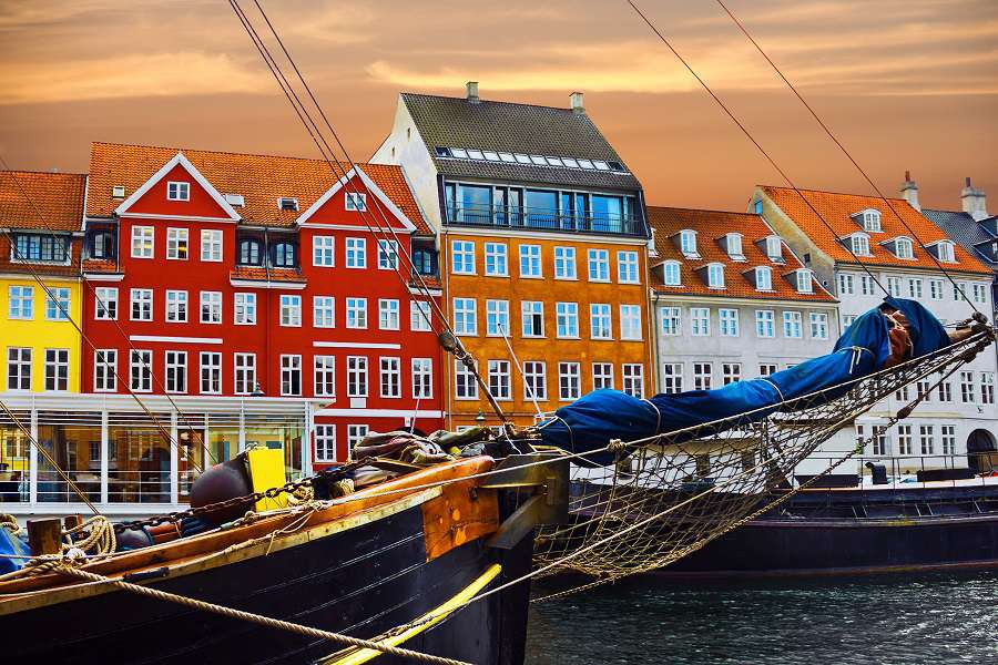 Copenhagen-Denmark.-Yacht-and-color-houses-in-seafront-Nyhavn-shutterstock_247564465