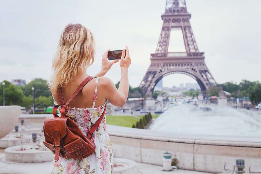 tourist-taking-photo-of-Eiffel-tower-in-Paris-with-compact-camera-or-smartphone-travel-in-Europe-shutterstock_424114555-1