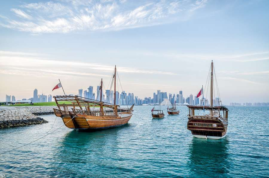 Doha-Dhows-moored-off-Museum-Park-in-central-Doha-Qatar-Arabia-with-some-of-the-buildings-from-the-citys-commercial-port-in-the-background.-shutterstock_252379561-2