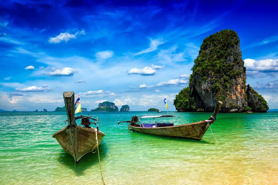 Long-tail-boats-on-tropical-beach-Pranang-beach-Krabi-Thailand-shutterstock_300313649