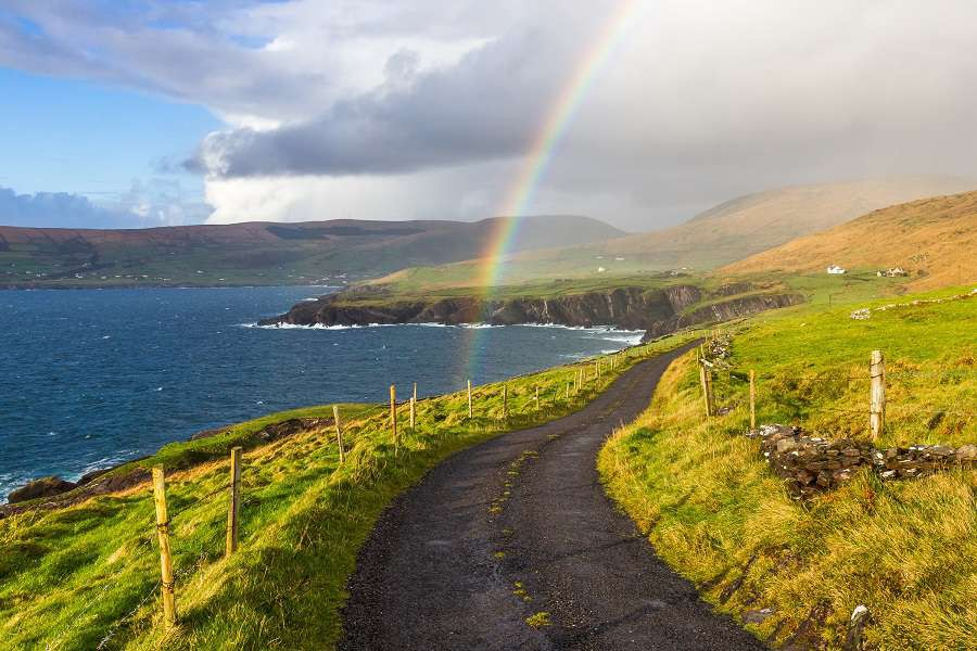 Typical-Ireland---Coast-green-grass-blue-skies-clouds-rain-coming-rainbow-Irlandia-shutterstock_392