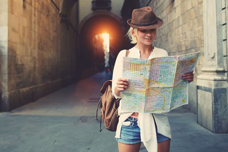Cheerful-woman-wanderer-with-trendy-look-searching-direction-on-location-map-while-traveling-abroad-in-summer-shutterstock_360572705
