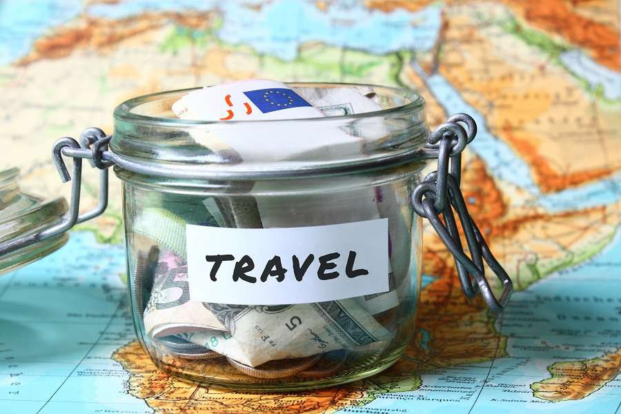 Travel-budget---vacation-money-savings-in-a-glass-jar-on-world-map-shutterstock_264209426