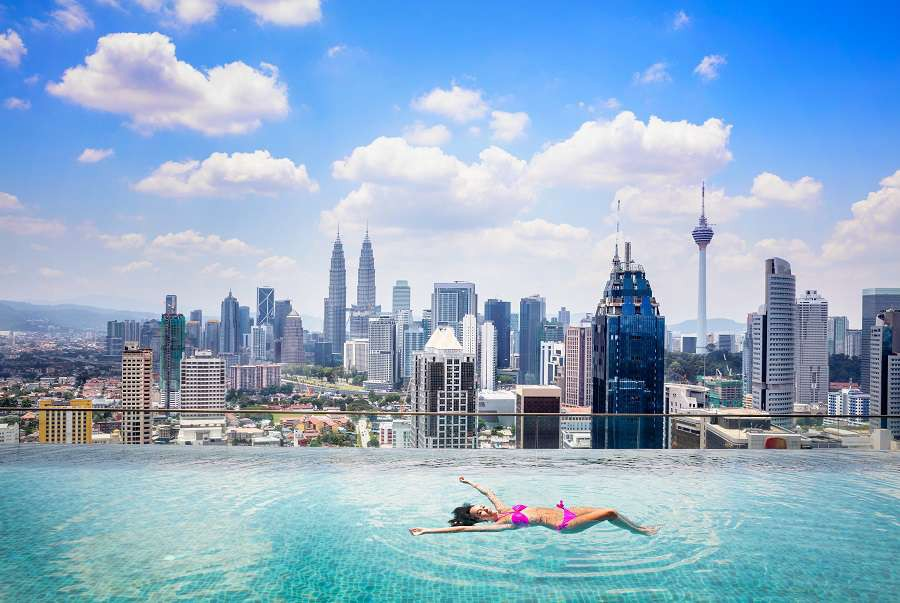 Swimming-pool-on-roof-top-with-beautiful-city-view-kuala-lumpur-malaysia-shutterstock_410063323-1