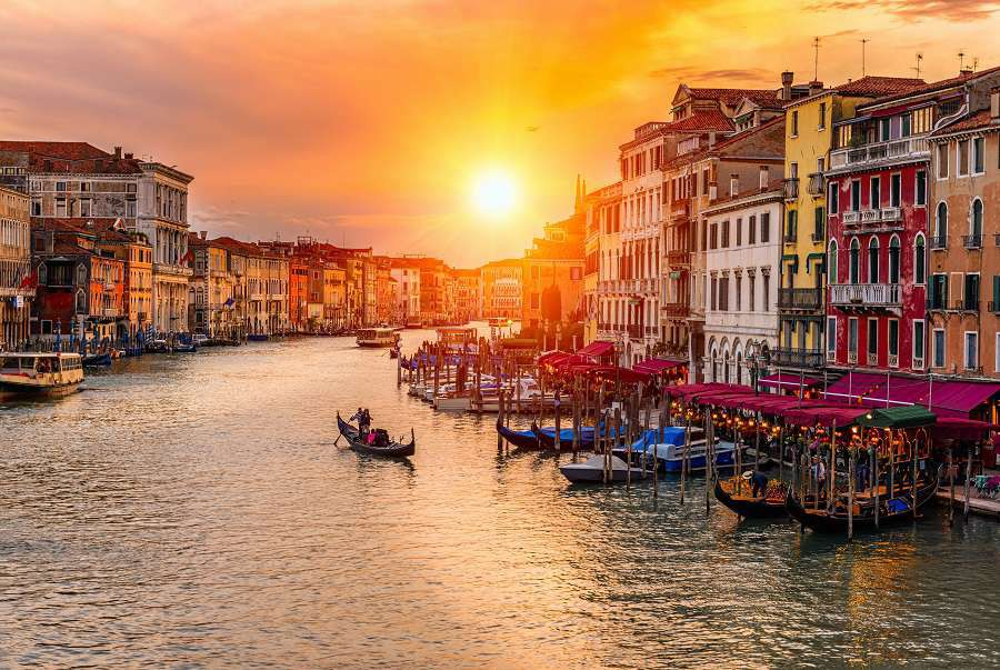 Grand-Canal-with-gondolas-in-Venice-Italy.-Sunset-view-of-Venice-Grand-Canal.-Architecture-and-landmarks-of-Venice.-Venice-postcard-shutterstock_557374438