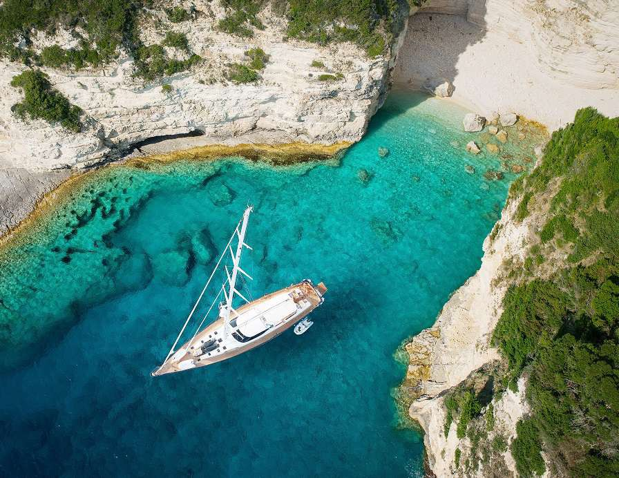 Luxury-yacht-in-amazing-bay-of-pure-Greece-Sea-shutterstock_485025304
