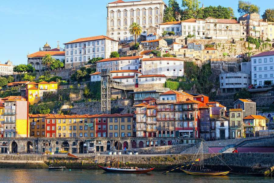 Multi-colored-old-houses-around-Ribeyr-Porto-Portugal-shutterstock_168016631