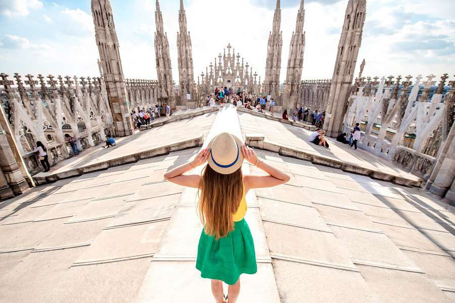 sBack-view-on-the-female-traveler-standing-on-the-rooftop-of-Duomo-cathedral-in-Milan.-Having-great-vacations-in-Milan-Mediolan-hutterstock_481189675-1