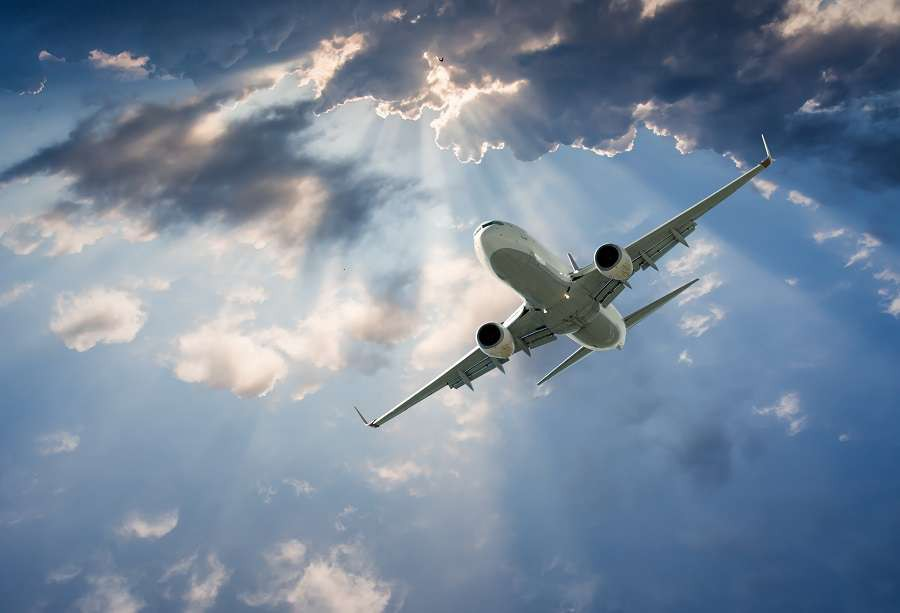 passenger-airplane-in-the-clouds.-travel-by-air-transport-samolot-shutterstock_294615899