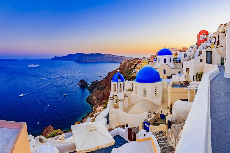 Amazing-sunset-view-with-white-houses-in-Oia-village-on-Santorini-island-in-Greece.-shutterstock_382976158