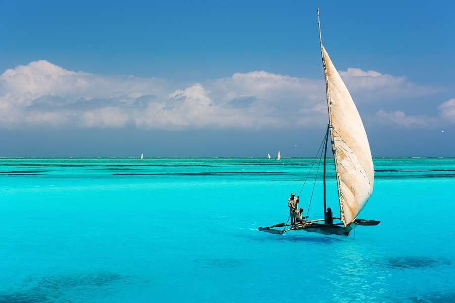 Catamaran-on-amazing-turquoise-water-in-the-Indian-ocean-next-to-Mnemba-atoll-Zanzibar-Tanzania-shutterstock_369745028