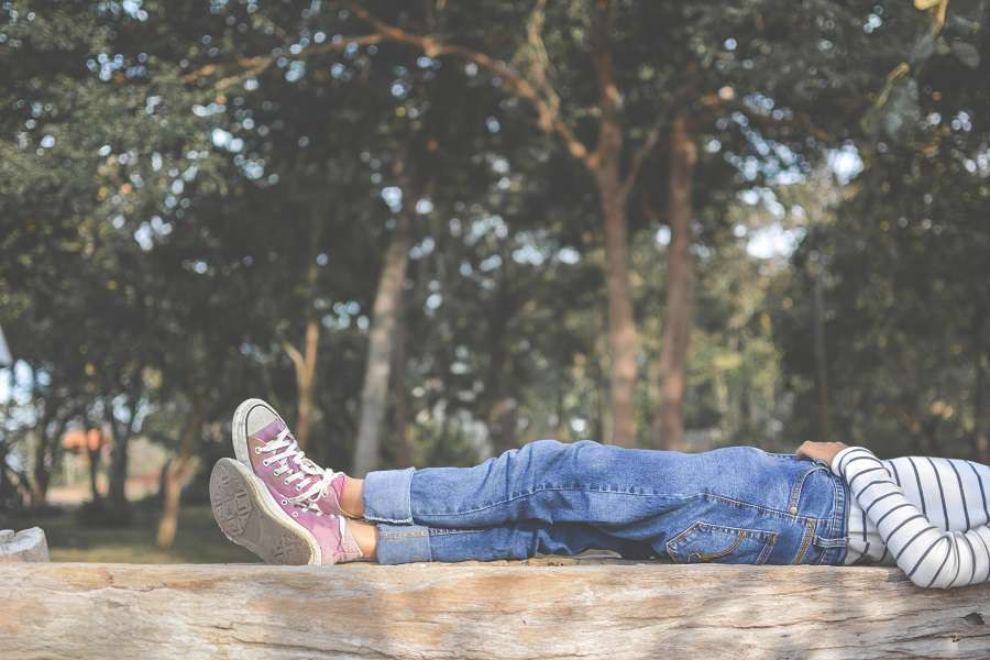 Feet-of-young-girl-sleep-in-the-park-on-nature-Relax-time-on-holiday-shutterstock_536419960-2