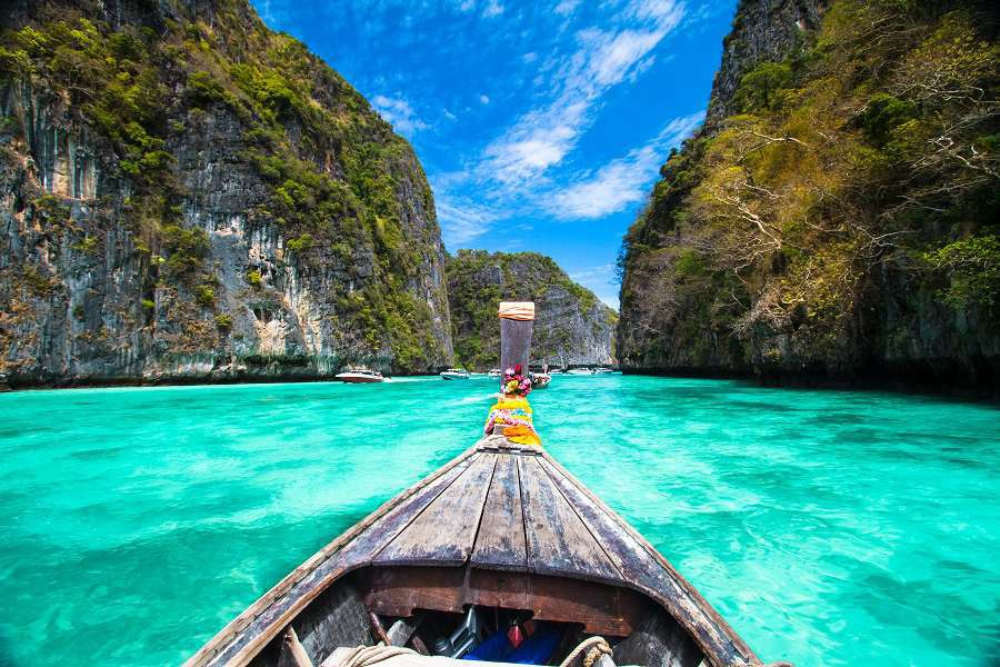 Traditional-wooden-boat-in-a-picture-perfect-tropical-bay-on-Koh-Phi-Phi-Island-Thailand-Asia.shutterstock_129916532-1