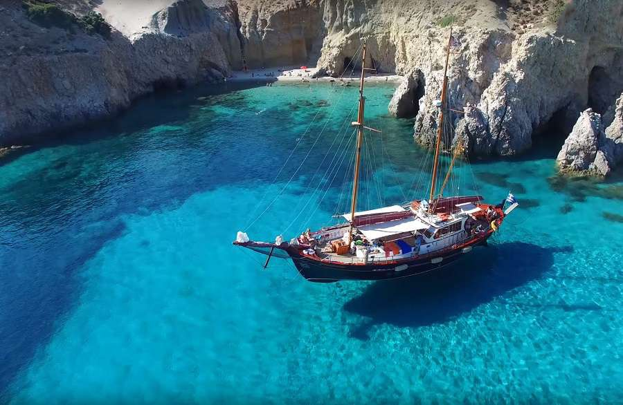 0.-Aerial-drone-photo-of-Kleftiko-clear-waters-in-island-of-Milos-Cyclades-Greece-shutterstock_544798480
