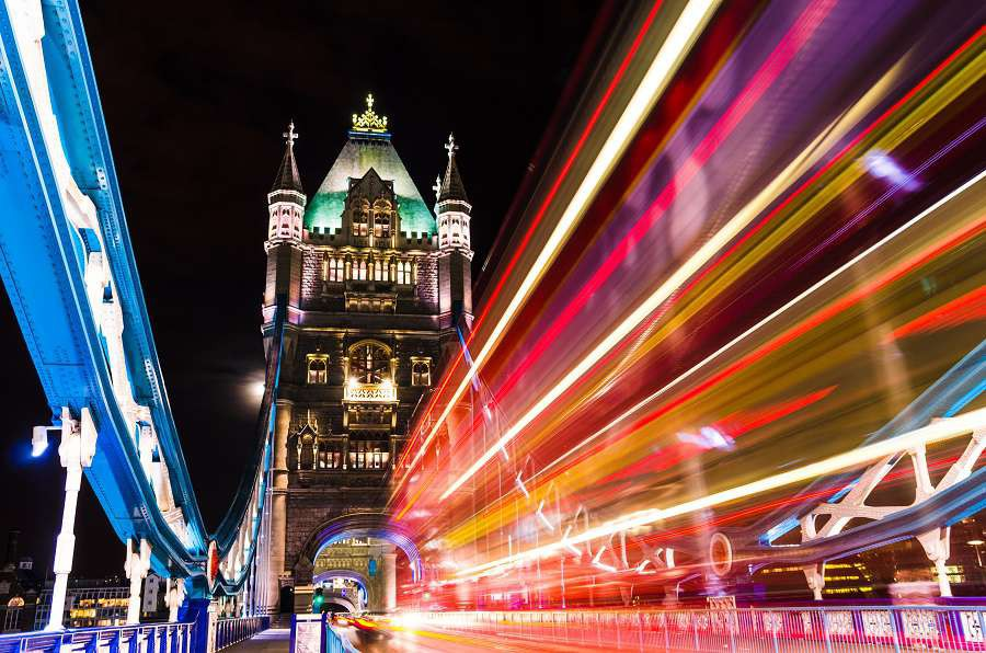 Tower-Bridge-in-London-UK-at-night-with-moving-red-double-decker-bus-leaving-light-traces-shutterstock_113113450