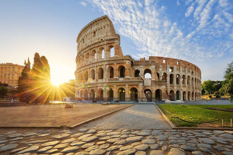 View-of-Colosseum-in-Rome-and-morning-sun-Italy-Europe.-shutterstock_433413835