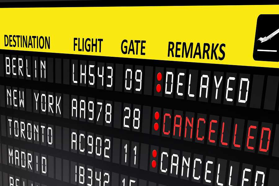 Flight-delayed-or-cancelled-display-panel-in-airport-shutterstock_244133716