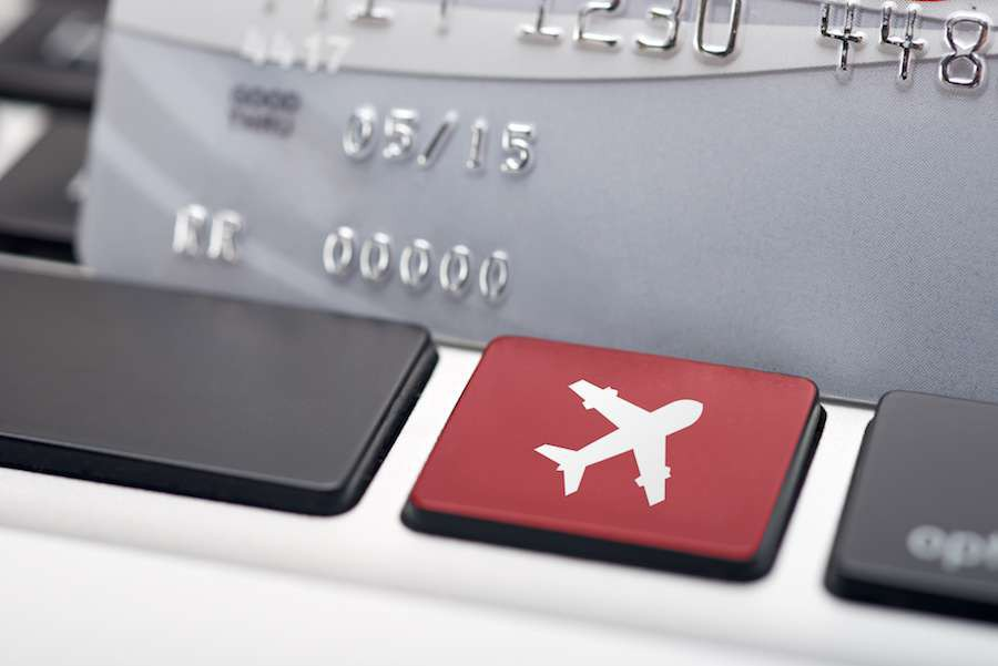Online-flight-booking-icon-button-of-a-computer-keyboard-shutterstock_116422108