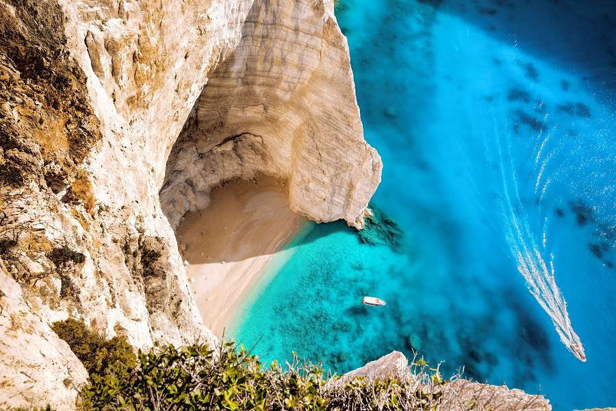 0.-Navagio-beach-with-boats-on-Zakynthos-islans-in-Greece-shutterstock_331462181