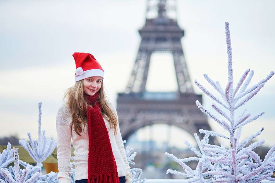 Pary-Girl-in-Santa-hat-near-the-Eiffel-tower-in-Paris-during-Christmas-time-shutterstock_305256767