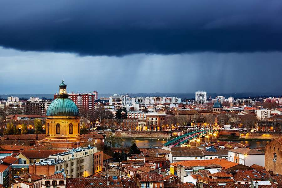 Rainy-evening-in-Toulouse-France-view-on-La-Grave-hospital-and-Saint-Pierre-bridge-Saint-Syprien-district-Tuluza-shutterstock_130545686