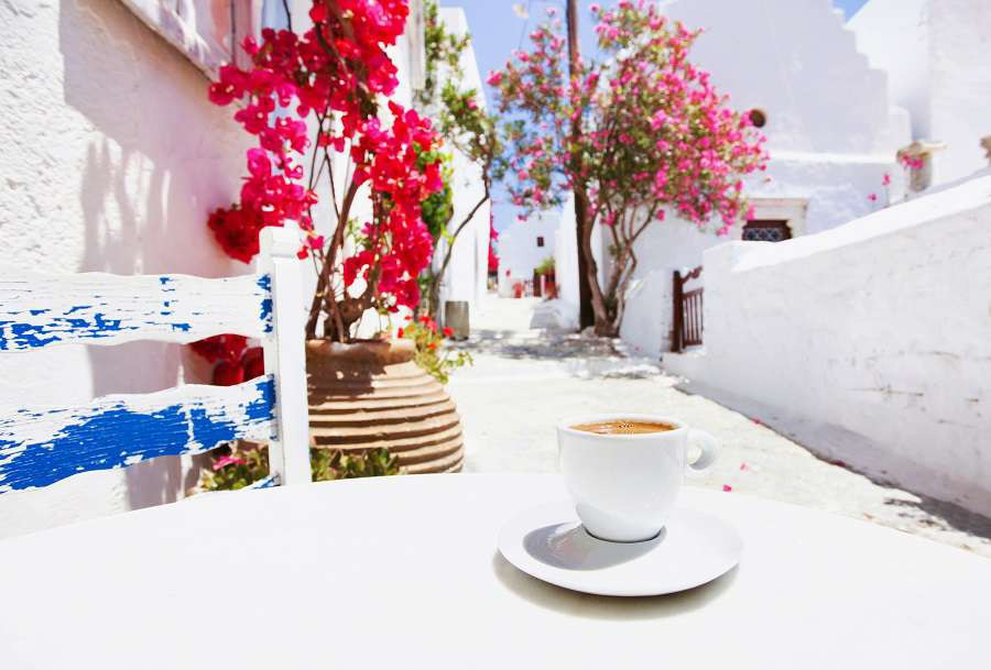 Traditional-greek-coffee-in-a-cafe-with-beautiful-mediterranean-street-on-the-background-shutterstock_435509836