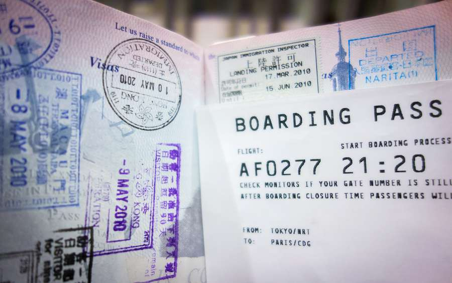 Airplane-boarding-pass-and-heavily-stamped-passport-indicating-frequent-travel.-shutterstock_532216675