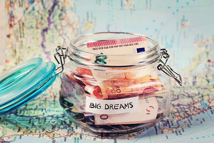 Piggy-bank-on-travel-tourist-map.-Saving-money-for-travel-planning-holiday-or-vacation-shutterstock_436596784