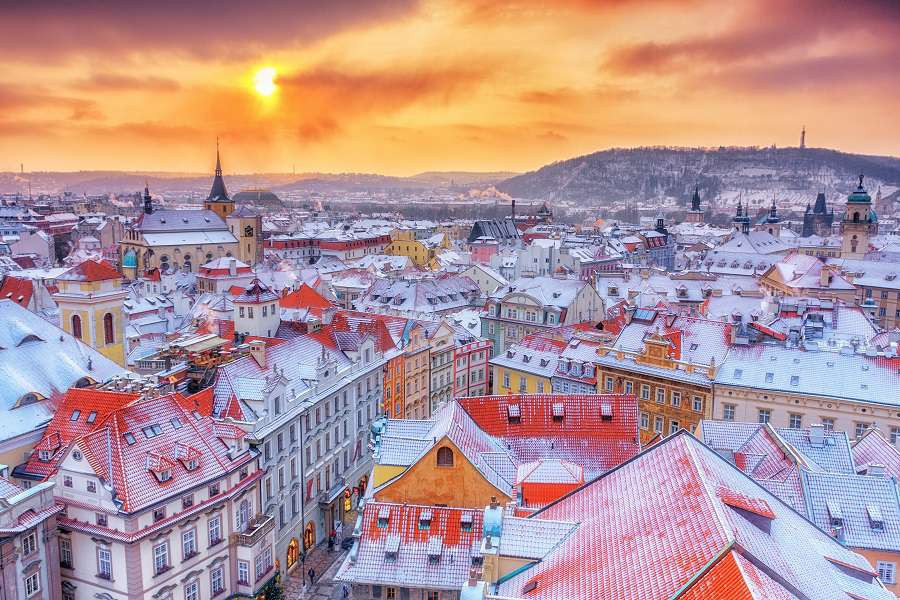 Prague-in-Christmas-time-classical-view-on-snowy-roofs-in-central-part-of-city.-shutterstock_514073659