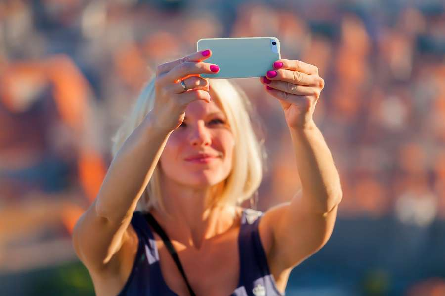 Female-traveller-make-a-selfie-photo-against-the-background-of-the-old-city-of-Dubrovnik-Travel-to-Croatia.-Summer-vacation-shutterstock_461601025