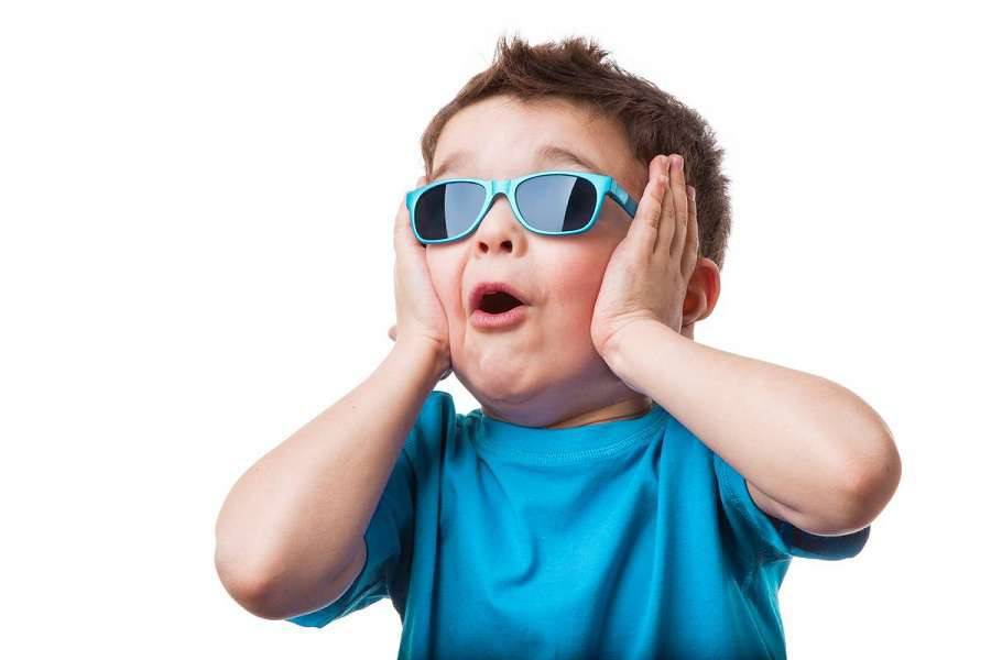 Cheerful-little-boy-in-sunglasses-express-surprised-face-isolated-on-white-background-shutterstock_364882781