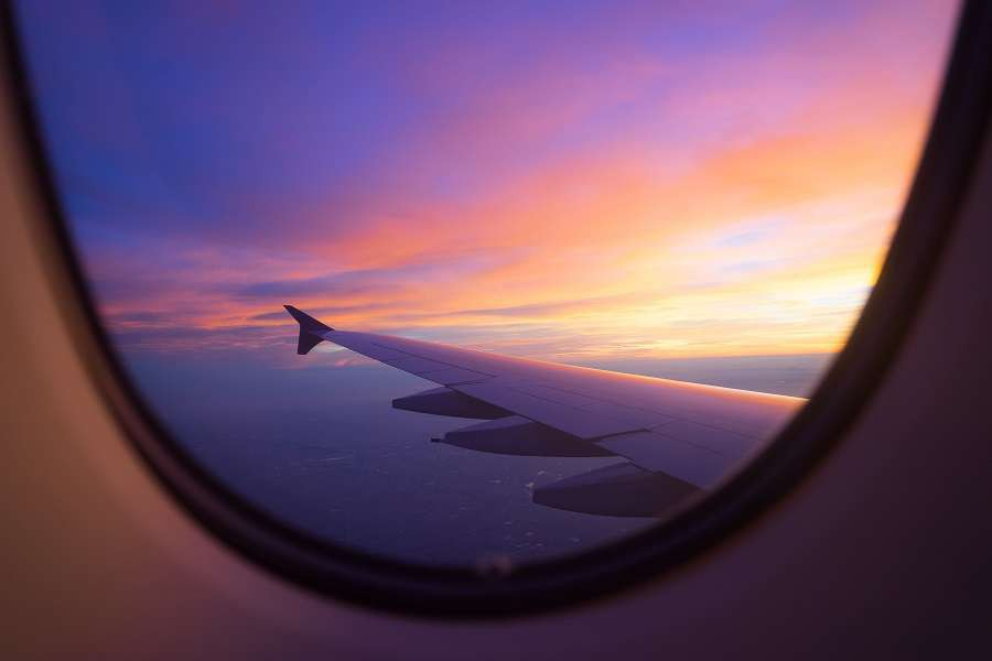 Sunset-sky-from-the-airplane-window-shutterstock_450483874